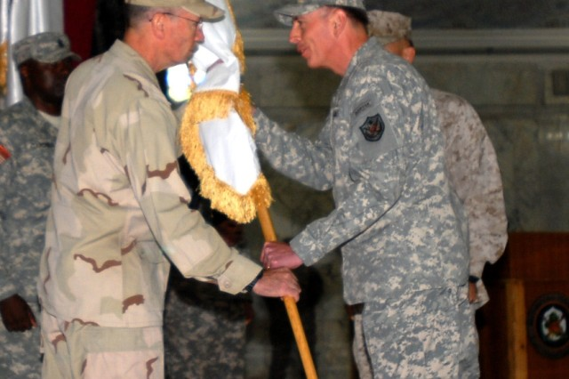 Army Gen. David Petraeus transfers authority of Task Force 134 to Navy Rear