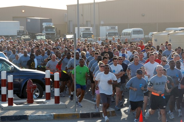 Some of the nearly 1,000 runners and walkers who participated in the U.S. Army birthday 5K Run/Walk at Camp Arifjan, Kuwait, June 14, 2008. Members of all service branches, DOD civilian employees, contractors, family members and others came together in celebration of the Army's 233rd birthday.