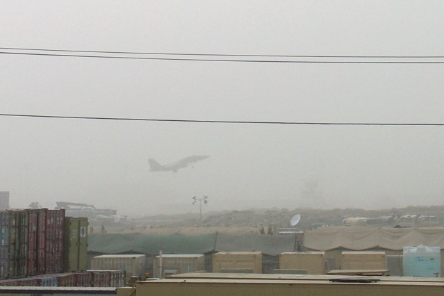 Obscured by a dust storm, an U.S. Air Force F-15 Eagle climbs on take off from Bagram Airfield, Afghanistan, June 14, 2008.