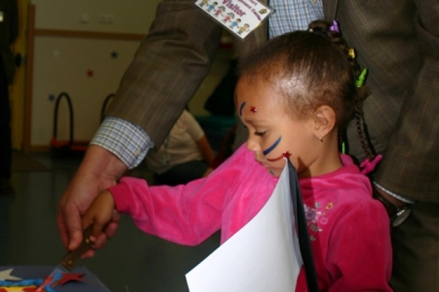 SCHWINFURT, Germany - John McIntyre, acting deputy commander of U.S. Army Garrison Schweinfurt, Germany, gets a little assistance cutting the Army Birthday cake from four-year-old Isis Didymus at the USAG Schweinfurt Child Development Center.