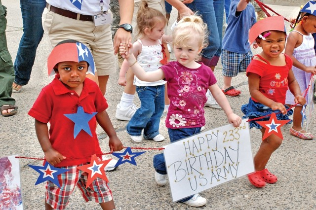 WIESBADEN, Germany - Youth from the U.S. Army Garrison Wiesbaden Child Development Center celebrate the Army's 233rd birthday during a parade on Wiesbaden Army Airfield, Germany.