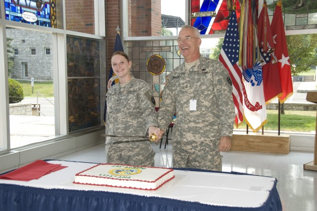 U.S. Army War College Commandant Maj. Gen. Robert Williams gets an assist from Pfc. Jennifer Rick, kicking off the post's Army Birthday celebration with staff, faculty and students.