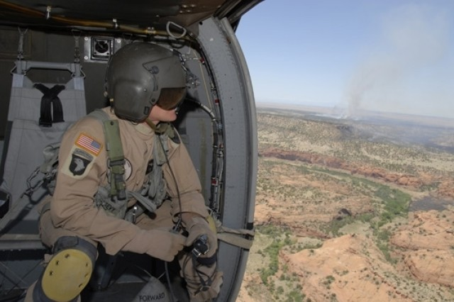 Sgt. Rick D. Peevy, a crew chief with the Colorado Army National Guard, surveys wildfires at Fort Carson, Colo.