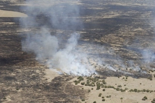 Wildfires burn at Fort Carson, Colo. National Guard Soldiers are also fighting wildfires elsewhere in the West.