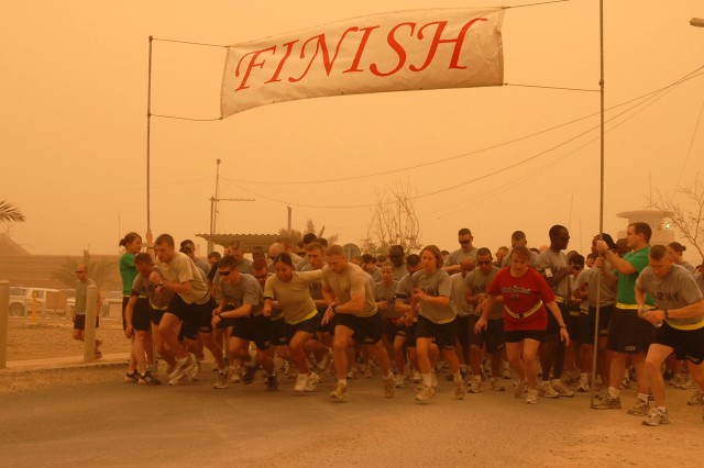 Runners take off on the 10K Fun Run 2008 June 8 on Victory Base Complex. Despite the dusty weather, many runners participated in the event.