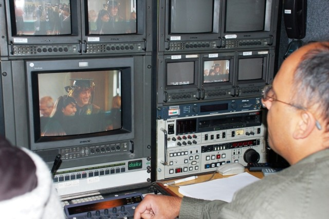 """The 39th Signal Battalion, based at U.S. Army Garrison Schinnen, Netherlands, supervised contracted technicians who provided television broadcast coverage of the AFNORTH International High School graduation ceremony to support a greater U.S. Army Europe-wide """"grad cast"""" via the Internet to deployed family members."""