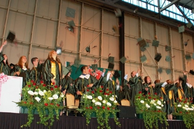Students from six nations celebrate their graduation from AFNORTH International High School, Brunssum, Netherlands, in a ceremony at the NATO Air Base in Geilenkirchen, Germany, June 13, 2008. Graduates in the ceremony represented Canada, Estonia, Germany, Netherlands, Norway, Turkey and the United States.