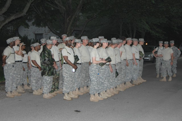 Soldiers from the Indiana National Guard's 38th Infantry Division arrive in New Harmony, Ind., preparing to build up the town levee on June 13, 2008. The Soldiers received a safety briefing before beginning to protect the area from the rising Wabash River.