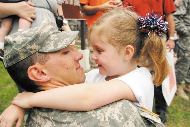 Spc. Steven Lucas and his daughter Allison Morter share a moment.