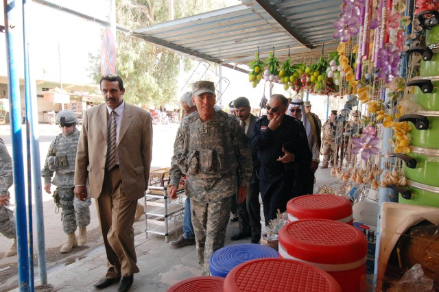 "Gen. David Petraeus, the commanding general of Multi-National Force - Iraq, takes a stroll through a market in downtown Hawijah, Iraq with key Kirkuk Provincial and its Security Forces' leadership during a ""Battle Field Circulation"" of northern Iraq on the Army's 233rd birthday, June 14. This was Petraeus' first visit to this northeastern district in the Kirkuk Province which was once considered the 'Anbar of the North' and has seen around a 90 percent drop in violent acts against Iraqi Security Forces, civilians, and the coalition force since the arrival of 1st Battalion, 87th Infantry Regiment, 1st Brigade, 10th Mountain Division to this region in September."