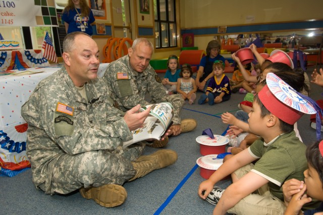 USAG-Yongsan Commander Col. Dave Hall (left) reads the Army story to toddlers and preschoolers at the Child Development Center on June 13 to celebrate the Army's 233rd birthday the next day.