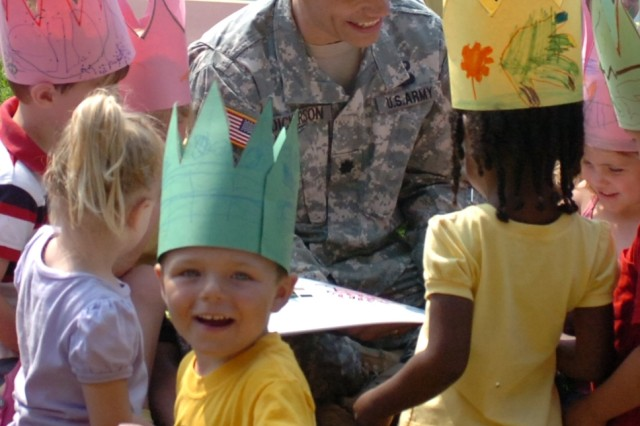 Carlisle Barracks Garrison Commander Lt. Col. Sergio Dickerson keeps almost everyone enraptured with the Army birthday storybook while at the post's Child Development Center June 13.