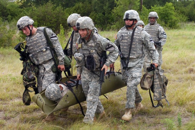 After treating their casualty, Soldiers from the 3rd Battalion, 82nd Field Artillery Regiment, 2nd Brigade Combat Team, 1st Cavalry Division evacuate him to a casualty collection point during combat lifesaver training at Fort Hood, Texas June 5.