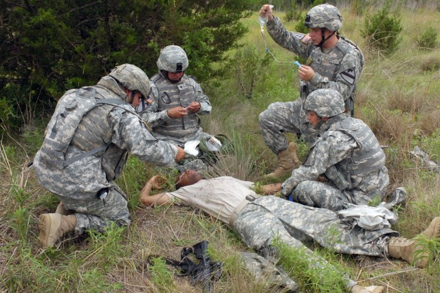 Soldiers from the 3rd Battalion, 82 Field Artillery Regiment, 2nd Brigade Combat Team,1st Cavalry Division attend to a simulated casualty during combat lifesaver training at Fort Hood, Texas June 5. Instead of the traditional classroom setting, these Soldiers conducted the course in the field to add to the realism of the training.