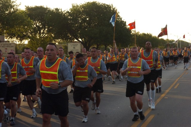Soldiers from the 2nd Brigade Combat Team, 1st Cavalry Division make their way down Battalion Avenue during the Black Jack Brigade run, which was held June 12 at Fort Hood, Texas in celebration of the Army's upcoming birthday