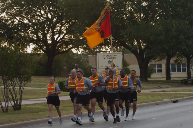 Col. Ryan Gonsalves, the commander of the 2nd Brigade Combat Team, 1st Cavalry Division runs with members of his staff while leading his Soldiers on a brigade run June 12 at Fort Hood, Texas. The Black Jack Brigade conducted the run in celebration of the Army's upcoming birthday.