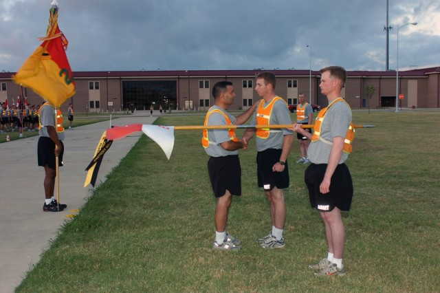Capt. Brent Kinney, the commander of Company E, 1st Battalion, 5th Infantry Regiment, 2nd Brigade Combat Team, 1st Cavalry Division, is congratulated by Black Jack Brigade commander, Col. Ryan Gonsalves after receiving a retention streamer, June 12 at Fort Hood, Texas. Gonsalves presented the streamer to Kinney before leading his Soldiers on a brigade run in celebration of the Army's upcoming birthday.