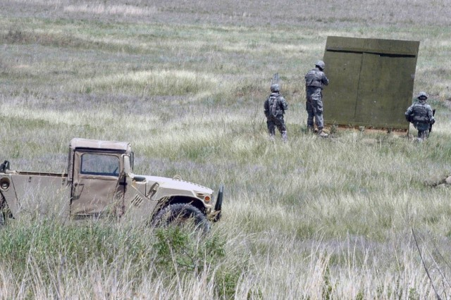 Two Soldiers perform buddy team movements as part of a live-fire training exercise June 11 at Fort Hood, Texas. A third Soldier observes and ensures the safety of those involved. 3rd Brigade Special Troops Battalion, 3rd Brigade Combat Team, 1st Cavalry Division intends to conduct these training exercises prior to their deployment to Iraq this winter.