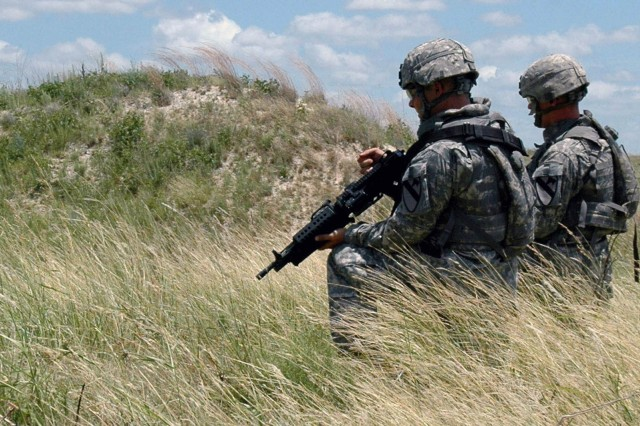 Two Soldiers with 3rd Brigade Special Troops Battalion, 3rd Brigade Combat Team, 1st  Cavalry Division, prepare to engage targets while conducting a buddy team live fire training exercise on Fort Hood, Texas July 11. This exercise is the culmination of a series of small arms weapons training events designed to give the Soldiers of 3rd BSTB the confidence in their abilities needed to engage the enemy.