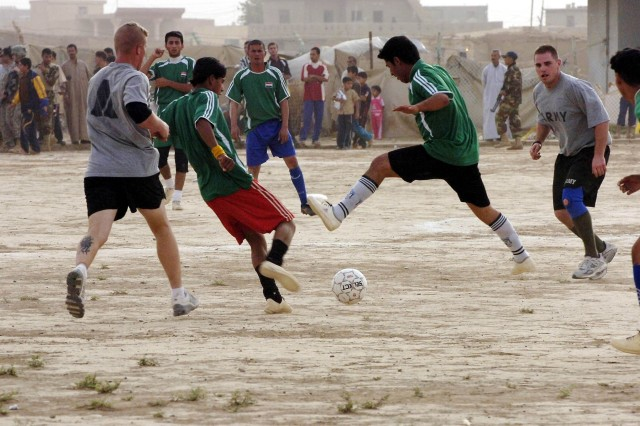 Soldiers of 1st Battalion, 87th Infantry Regiment, 1st Brigade, 10th Mountain Division compete against a soccer team comprised of Sons of Iraq members in Riyadh, Iraq, June 11. The Soldiers lost to the Iraqis, 4-1, in the second of a five-game series which will match the Soldiers against teams around the Hawijah District located in the Kirkuk Province of northeastern, Iraq. The Soldiers lost the previous week to a team from Mahus, 6-1.