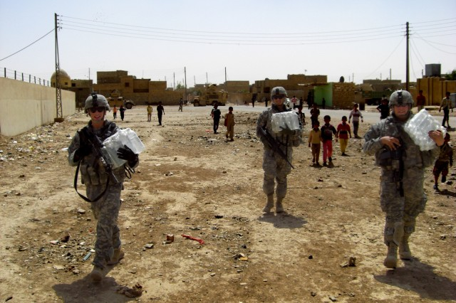 U.S. Army, Europe Field Artillery Soldiers help displaced Families in Iraq
