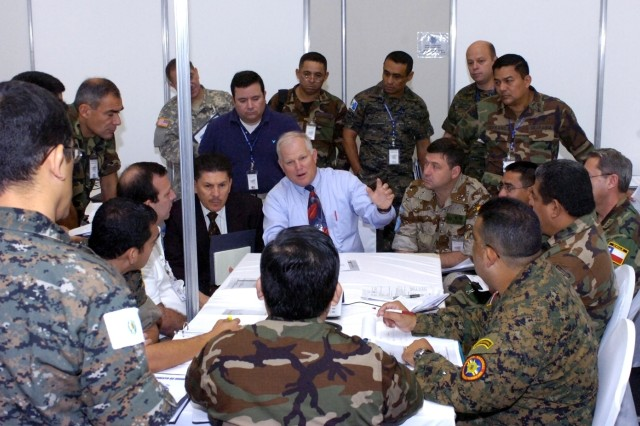 MANAGUA, Nicaragua - Mr. Roger Astin, exercise scenario manager of U.S. Army South, briefs a group of multinational officials during PKO North '08.
