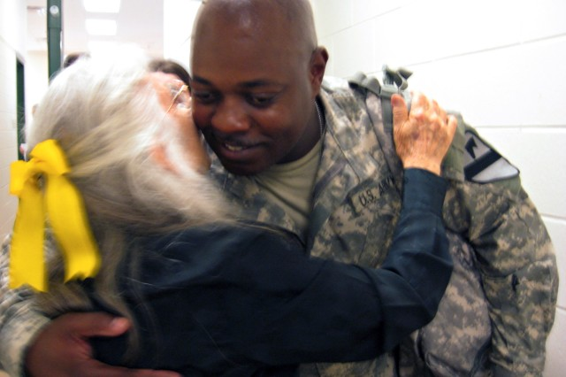 Chief Warrant Officer 3 Mickael Tatum, a targeting officer for the 1st Cavalry Division's 4th Brigade Combat Team and a native of Corpus Christi, Texas hugs Elizabeth Laird, Fort Hood's hug lady, at Robert Gray Army Airfield June 10.  Laird hugs every Fort Hood Soldier before they deploy.