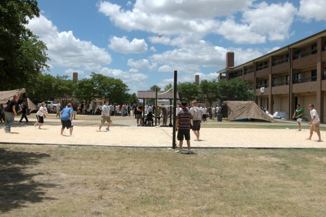 """Soldiers from 615th Aviation Support """"Cold Steel"""" Battalion, 1st Air Cavalry Brigade, 1st Cavalry Division, play in a volley ball tournament during a farewell party held for their sister unit, the 404th Brigade Support Battalion, 4th Combat Aviation Brigade, 4th Infantry Division, June 12 at Fort Hood, Texas. There was also live music and food for the enjoyment of the Soldiers. The Providers are headed to Iraq for a 15-month deployment."""