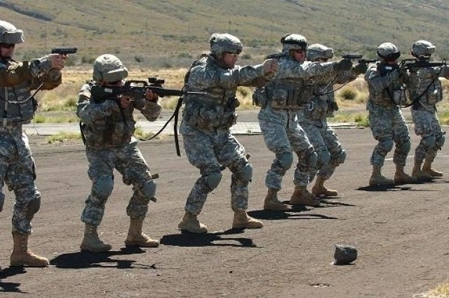 Soldiers with 3rd Battalion, 25th Aviation Regiment, 25th Combat Aviation Brigade simulate shooting targets during a training exercise, May 4.  The Soldiers were part of the 25th CAB's largest training exercise since redeployment at Pohakuloa Training Area, on the Big Island of Hawaii.