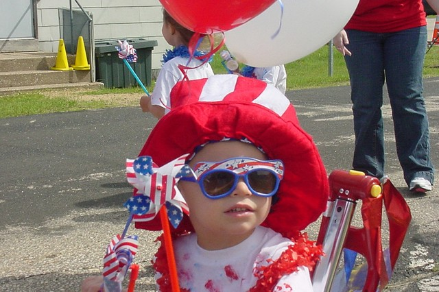 Logan Walley, a preschooler at the Fort McCoy, Wis., Child Development Center, shows off his patriotic spirit during a Child and Youth Services Army Birthday and Flag Day Doll and Buggy Parade June 13.