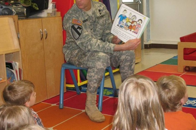 """Garrison Commander Col. David E. Chesser reads """"Happy Birthday U.S. Army"""" to preschoolers at the Fort McCoy, Wis., Child and Youth Services June 13."""
