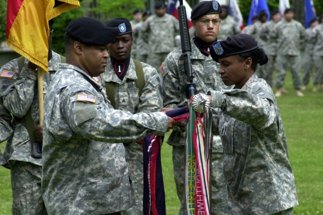 Col. Richard L. Shepard, commander of the 38th Personnel Services Battalion - the last PSB in the active Army - joins battalion Command Sgt. Maj. Annette R. Weber in casing the 38th's colors in an inactivation ceremony on Warner Barracks in Bamberg, Germany June 11.