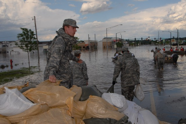 Here is a view of Iowa City, Iowa. Soldiers throughout the Midwest are assisting with evacuations, search and rescue, security, sandbagging, generator support, providing emergency drinking water, removing debris and repairing damaged infrastructure.