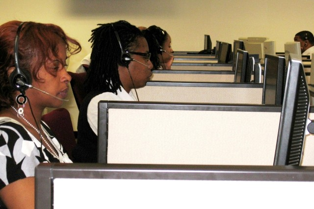 Deqa Mohamud, Tameka Thompson and Michelle Reece (left to right) are part of a now more robust Army Knowledge Online / Defense Knowledge Online Help Desk that provides round-the-clock technical support to world-wide customers.