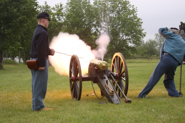 Re-enactors representing Civil War Soldiers fire a period cannon during a living history timeline at Fort Drum June 14 which presented the dress and weapons of warriors from Fort Drum's history.