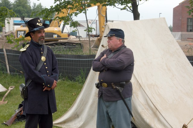 Civil War re-enactors talk during a living history timeline of Fort Drum June 14.  The timeline event was held to give visitors a tactile sense of the clothing and equipment used by the warriors from local Native American tribes through the Civil War and on to the modern Soldiers serving in Iraq and Afghanistan.