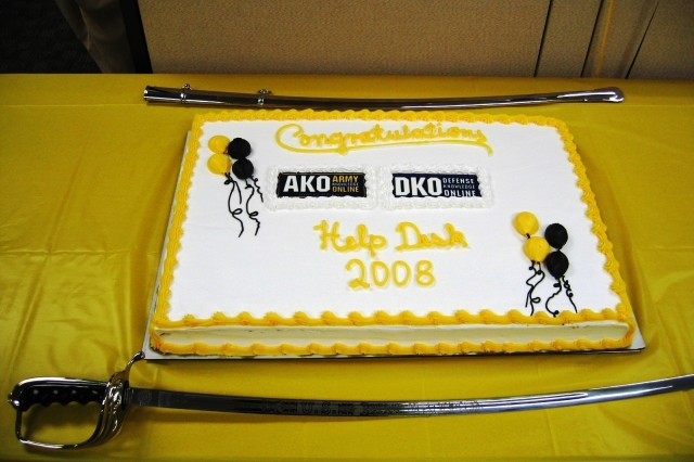 A cake displaying the logos for Army Knowledge Online and Defense Knowledge Online was the centerpiece of a June 18 ribbon-cutting ceremony held in the new AKO/DKO Help Desk facility.