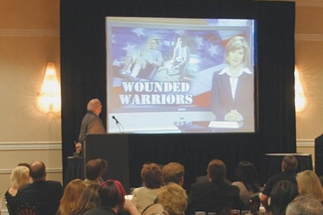A video narrated by Laurie Ott, GAB award-winning newscaster, detailing Moss' injury and treatment is shown prior to the award presentation.