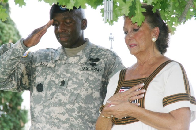 Rita Van Autreve, wife of the late Sgt. Maj. of the Army Leon Van Autreve, and Command Sgt. Maj. Howard Riles, command sergeant major, Fort Sam Houston and Army Medical Department Center and School, pause for a moment in honor of the former sergeant major of the Army June 13 after the wreath-laying ceremony at the Fort Sam Houston National Cemetery.
