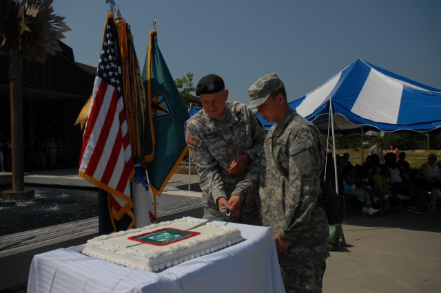 Brig. Gen. James H. Schwitters, Fort Jackson's commanding general, and Pvt. Matthew White, the youngest Soldier in the 165th Infantry Regiment, cut the Army birthday cake during a ceremony at Patriot Park Saturday.