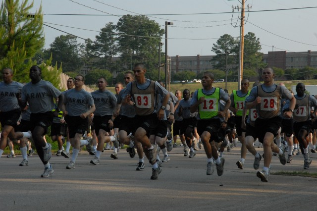 """Runners are off in the 5K run Saturday morning. The run started and ended near the MG Robert B. Solomon Center and took participants past Semmes Lake. Sgt. 1st Class Greg Wyrobek, 282nd Army """"Victory"""" Band, won in 17 minutes, 9 seconds. See page 20 for more photos of Fort Jackson's Army Birthday celebration."""