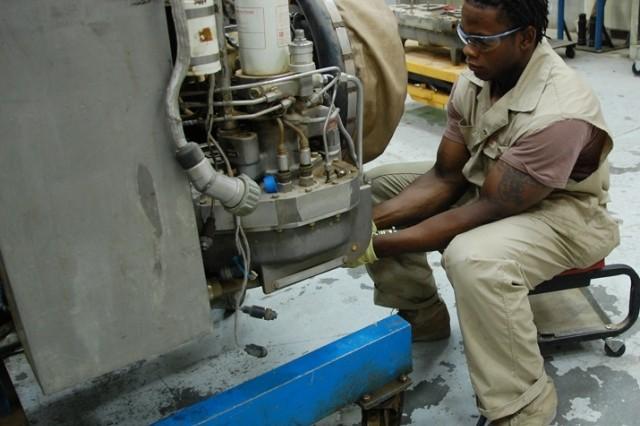 turbine engine mechanic malcolm lindsey prepares an agt1500 m1 tank