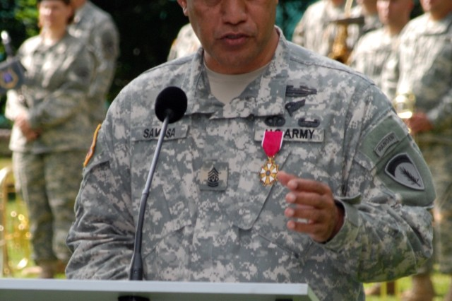 Command Sgt. Maj. Iuniasolua T. Savusa, U.S. Army Europe's outgoing command sergeant major, bids farewell to Soldiers, Family members, civilian employees and other guests during a retreat ceremony in Heidelberg, Germany, June 18. Savusa, who served as USAREUR's senior enlisted member since May 2006, was recently selected to serve as the command sergeant major for the International Security Assistance Force in Afghanistan.