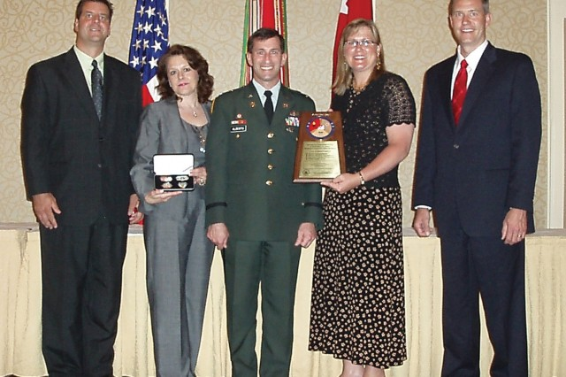 From left, Michael Rusinko, Cindy Evans, Col. Ron Alberto, Suzanne Rudat and Ed Farrell represent Tobyhanna Army Depot at the 2008 Combined Logistics Excellence Awards ceremony June 3.  Depot employees earned the 2008 Army Chief of Staff Maintenance Excellence Award for Depot Maintenance.