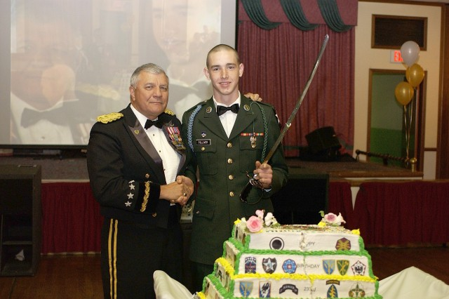 General Richard Cody, vice chief of staff, cuts the Army birthday cake with the help of Fort Lewis' youngest Soldier, Pvt. Steven Tolliver, 1-23 Inf.