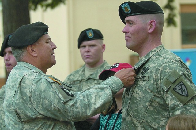 General Richard Cody pins the Bronze Star Medal for valor on Staff Sgt. Dwight Cross of the 571st MP Co.