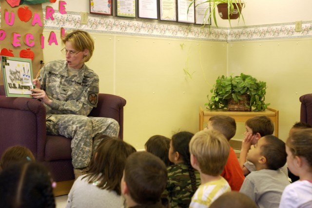Col. Cynthia Murphy, Fort Lewis garrison commander, teaches children at Clarkmoor CDC about the Army's rich history. She was taking part in an Army-wide effort to read a new children's book about the Army birthday to Soldiers' children. The book was read to more than 60,000 children last week around the world.