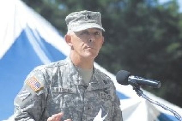 Brigadier Gen. James Huggins, 3rd Inf. Div. Assistant Division Commander for Maneuver was presented the Legion of Merit during the June 13 retreat ceremony. (United States Army Photos by Sgt. Tanya Polk, 3rd Inf. Div. Public Affairs)