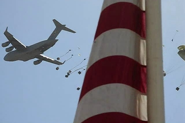 A U.S. Air Force C-17 Globemaster III airdrops rations to coalition forces at Forward Operating Base Baylough in Zabul Province, Afghanistan, Jun 12, 2008.