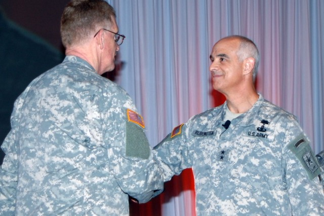Surgeon General of the Army Lt. Gen. Eric Schoomaker, shakes hands with Maj. Gen. David Rubenstein, June 9, at Fort Sam Houston, Texas.  Rubenstein assumed the position of chief of the U.S. Army Medical Service Corps and also serves as the Army's Deputy Surgeon General.